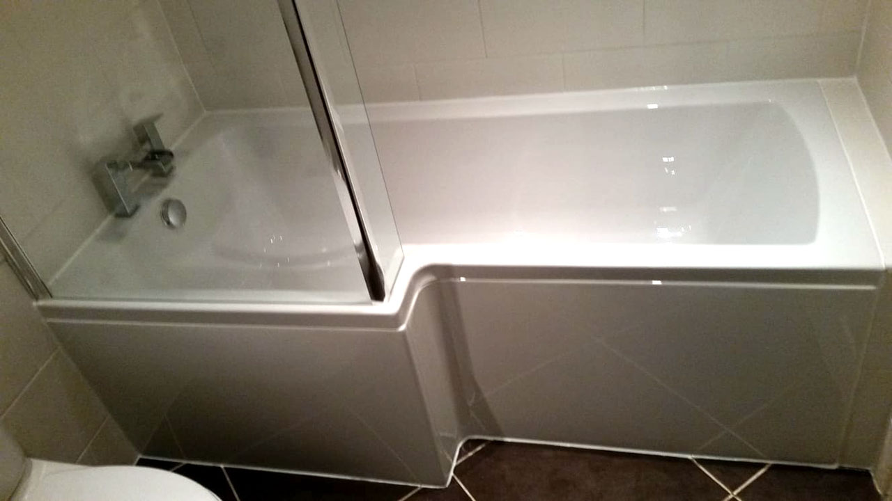 Completed L-shaped bath installation basingstoke