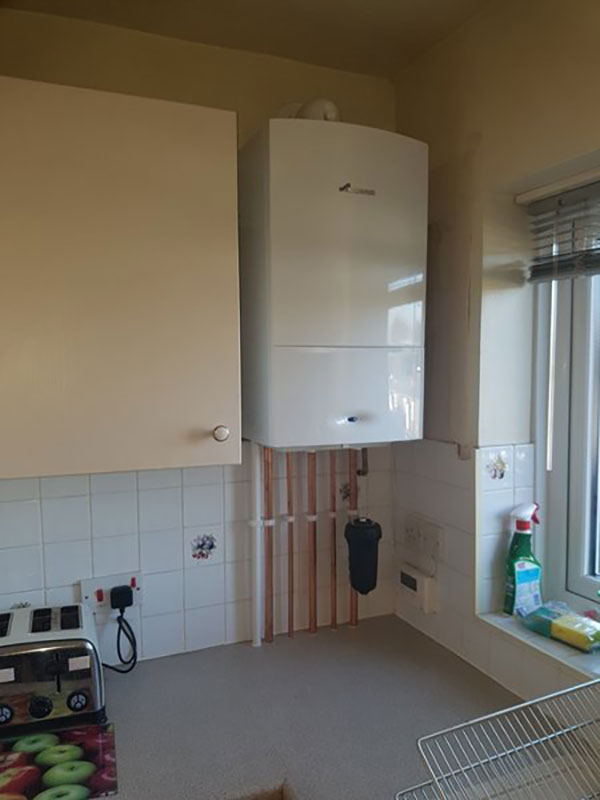 conventional heating system converted to Worcester combi boiler in kitchen